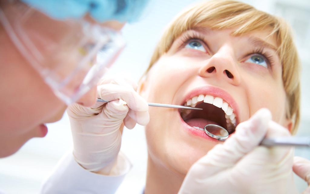 Посетите стоматолога для лечения флюса